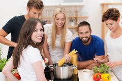 Teamwork in the kitchen Stock Photos