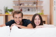 Happy relaxed young couple at home Stock Photos