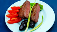 Stock Video Footage of meat food : roasted fillet mignon on blue plate with chives