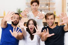 excited group of young men and women - stock photo