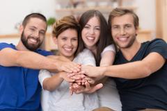 teamwork amongst friends - stock photo