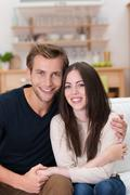 Stock Photo of loving young couple in their living room