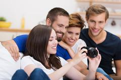 group of friends checking out a photo - stock photo