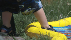 Toddler  stepping into a wading pool. Stock Footage