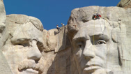 Stock Video Footage of Men rappelling down Mount Rushmore National Memorial