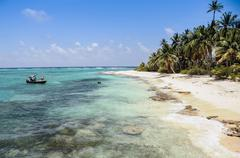 Arriving to a perfect untouched wild caribbean beach at san andres island. co Stock Photos