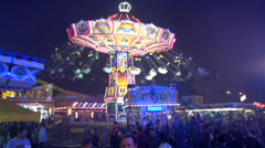 Chairoplane by night Stock Footage