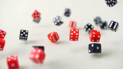 Red and black Dice rolling, Slow Motion Stock Footage
