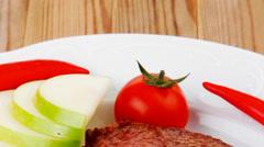 Meat food : roast rib on white dish Stock Footage