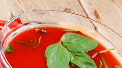 Tomato soup with basil thyme and raw tomatoes Stock Footage
