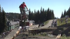 Sports & fitness, mountain bike 2 jumps, through frame wide shot Stock Footage