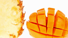 Exotic tropical fruits - mango and pineapple Stock Footage