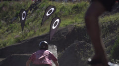 Sports, mountain bike jump, reverse angle 2 bikes going away, true 240fps slo mo Stock Footage
