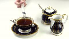 Poisoned cup of tea Stock Footage