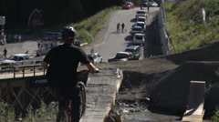 Sports & fitness, mountain bike jump, 3 bikes quick succession, long shot - stock footage