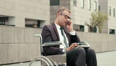 4of15 Health and handicap, business people on wheelchair outdoors - stock footage
