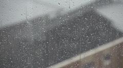 Weather, rain falling on window Stock Footage