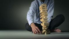 Block tower collapsing, Slow Motion Stock Footage