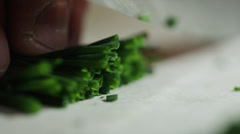 CUTTING CHIVES WITH KNIFE (SLOW MOTION) - stock footage