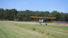 STEARMAN BI PLANE TAKING OFF Stock Footage