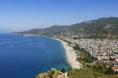 turkey, alanya, view of cleopatra beach and castle in background - stock photo