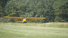 AUSTER YELLOW AIRPLANE TAKING OFF Stock Footage