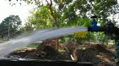 Locked-on shot of running water for irrigation Stock Footage