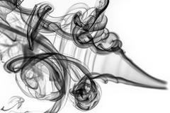 Abstract pattern: black smoke swirls and curves Stock Photos