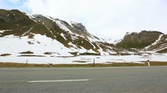 Pan shot of a snow covered mountain range Stock Footage