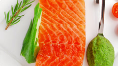 Fresh smoked salmon fillet with pesto sauce Stock Footage