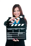 Businesswoman holding clapper board - stock photo