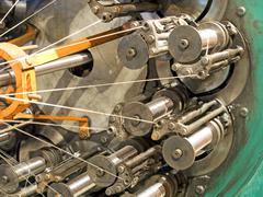 The braiding machine of flexible metal hose production line taken closeup. Stock Photos