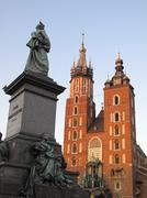 poland, krakow, monument of great polish poet adam mickiewicz and st mary the - stock photo