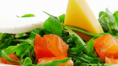 Salad with salmon in green bowl Stock Footage
