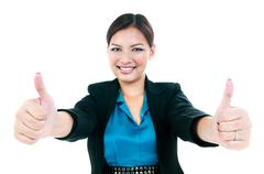 Businesswoman giving two thumbs up gesture - stock photo