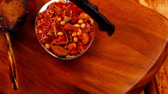 Stock Video Footage of meat savory on wooden plate: roast ribs