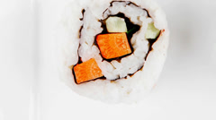 Classic California Sushi Roll with Avocado and Salmon Stock Footage