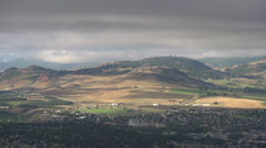 Time-lapse, low clouds and shadows over hill, nice movement Stock Footage