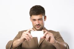Young man with smartphone, close up Stock Photos