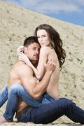 Germany, bavaria, young topless lovers in sand dunes Stock Photos