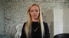 Young female speaks on a video conference Stock Footage