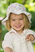 Germany, baden wuerttemberg, portrait of girl in garden, smiling Stock Photos