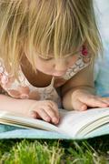 Germany, baden wuerttemberg, girl reading book, close up Stock Photos