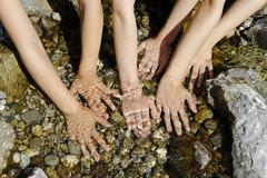 Stock Photo of france, boys and girls hands in water