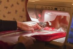 Germany, laupheim, mature woman embroidering with semi-professional embroider Stock Photos