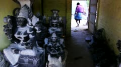 Pan shot of statues of Hindu god - stock footage