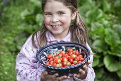 Stock Photo of germany, north rhine westphalia, cologne, portrait of girl holding bowl of st