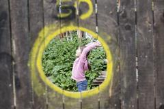 Germany, cologne, girl playing in playground Stock Photos