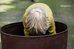 Germany, north rhine westphalia, cologne, boy standing in barrel, close up Stock Photos