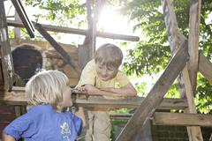 Stock Photo of germany, north rhine westphalia, cologne, boys in playground, smiling